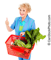 Thumbs Up For Nutrition - Beautiful senior lady shopping for...