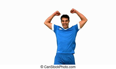 Happy football player raising arms on white screen in slow...