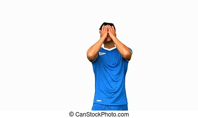 Angry football player holding his head on white screen