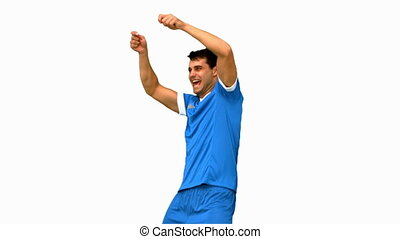 Happy football player gesturing after a goal on white screen...