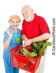 Organic Produce is AOkay - Senior couple shopping for...