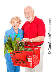 Senior Couple Shops Healthy - Senior couple shopping for...