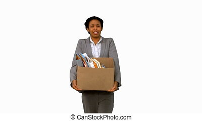 Fired businesswoman dropping a box on white screen in slow...