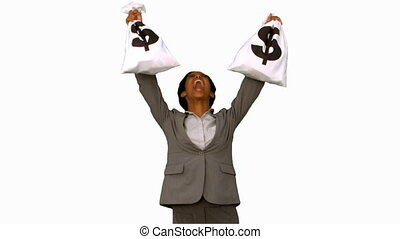 Businesswoman holding money bags on white screen in slow...