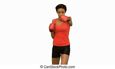 Attractive woman boxing on white sc