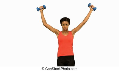 Woman lifting dumbbells on white screen in slow motion