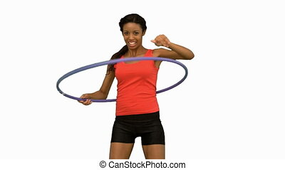 Woman playing with a hula hoop on white screen in slow...