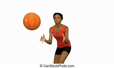 Woman catching and throwing a basketball on white screen in...