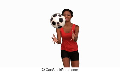 Woman catching a football on white screen in slow motion