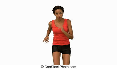 Woman jogging on white screen in slow motion
