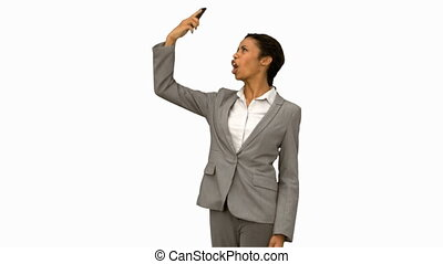 Angry woman raising her phone in the air on white screen in...