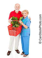 Senior Shoppers Full Body - Beautiful senior couple food...