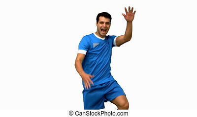Football player celebrating a goal on white screen in slow...