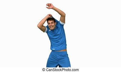 Cheerful football player celebrating a goal on white screen...