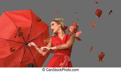 Pretty glamour woman holding a broken umbrella