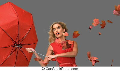 Pretty woman holding a broken umbrella