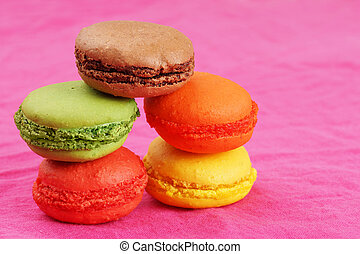 Pile of macaroons on pink