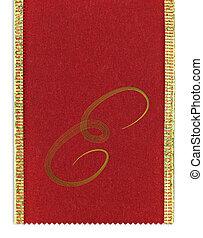 Textile monogram letter E on a ribbon