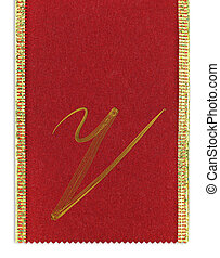 Textile monogram letter V on a ribbon