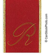 Textile monogram letter R on a ribbon