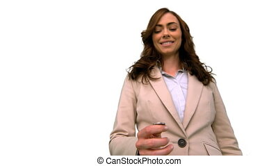 Businesswoman throwing a coin in the air on white screen
