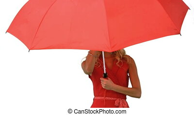 Woman holding an umbrella on white screen in slow motion