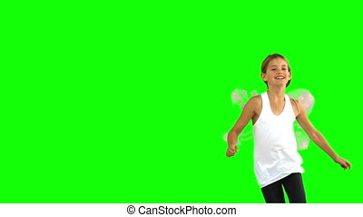 Little girl wearing dragonfly wings on green screen in slow...