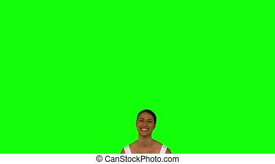 Woman wearing red gloves and jumping against a green screen