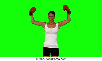 Woman showing her red boxing gloves