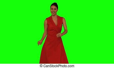 Sensual woman dancing against a green screen