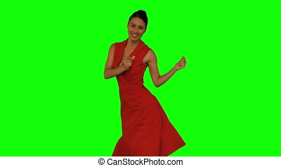 Beautiful woman dancing against a green screen