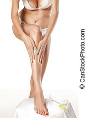 body lotion - Girl apply body lotion to her leg