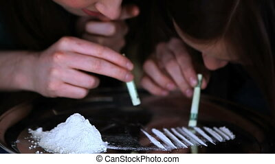 Friends snorting cocaine together