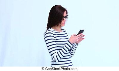 Beautiful trendy woman having phone