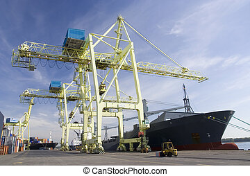 Port Cranes unloading a Ship - Giant container crane...