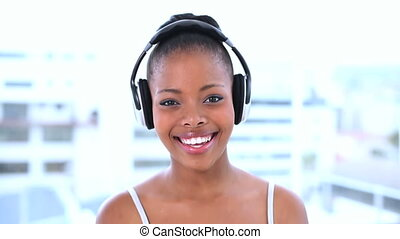 Smiling beautiful model listening t