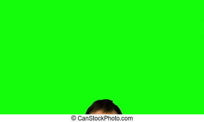 Attractive model holding her mat jumping on green background