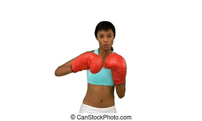 Sexy model with red gloves boxing on white background
