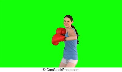 Energetic model with boxing gloves cheering on green...
