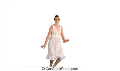 Beautiful model in white dress jumping on white background