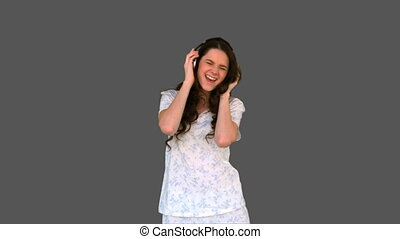 Happy young model in pyjamas listeng to music - Happy young...