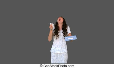 Sick young woman sneezing on grey background
