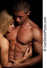 Love couple - Young and fit topless couple in an embrace on...