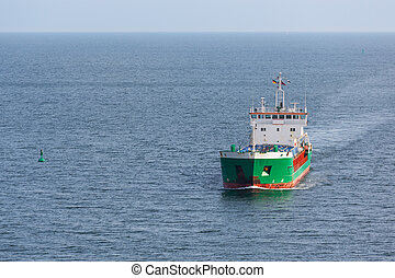 Aerial view of a freighter sailing at the big blue sea