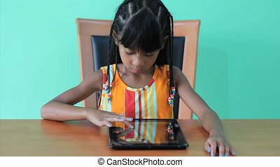 Seven Year Old Girl Using Tablet - A cute seven year old...