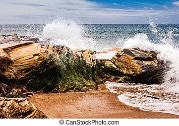 Portuguese coastline. - Splash against rocks at the shore of...