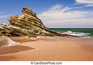 Portuguese coastline. - Rock at the beach of Porto Covo...