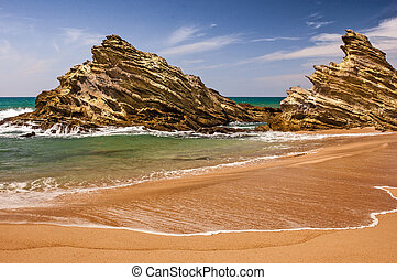 Portuguese coastline. - Rocks at the beach of Porto Covo...