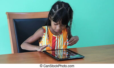 Girl Loves Using Her Digital Tablet - A cute seven year old...
