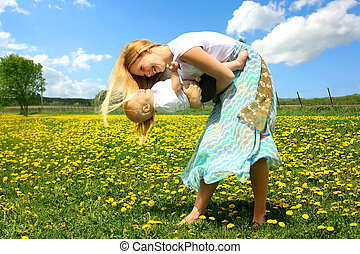Mother and Baby Dancing Outside - a young, attractive blond...